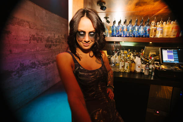 Romina prepares for a particularly busy Saturday night behind the bar.