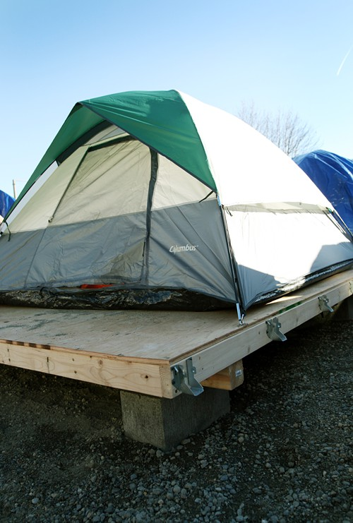 Heres a finished foundation. The metal brackets will eventually secure a protective covering over the tent.