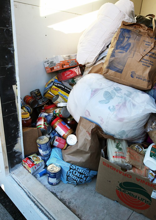 This was the temporary pantry, in one of the Tiny Houses. Donations so far have been wonderful, said Steve,