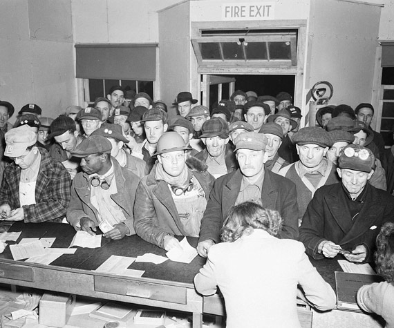 Payday at Hanford in 1944. this is inside a western union, and workers often sent money home to their families.