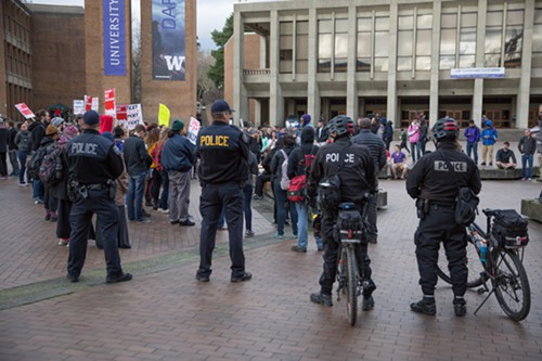 UW Police watch the crowd of anti-Trump counter demonstrators