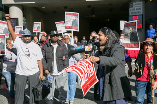 Seattle City Council Member Kshama Sawant speaks to the crowd near SPD HQ
