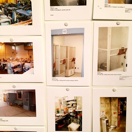 These photographs, tacked to the gallery wall, were evidence in the class-action lawsuit brought by prisoners against the state of California.