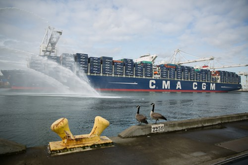 The massive container ship, CMA GCM Benjamin Franklin is unloaded at the Port of Seattles Terminal 18