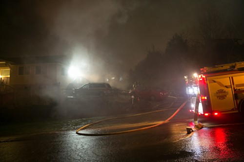 Smoke billows from a home near the corner of 20th and Plum on Beacon Hill