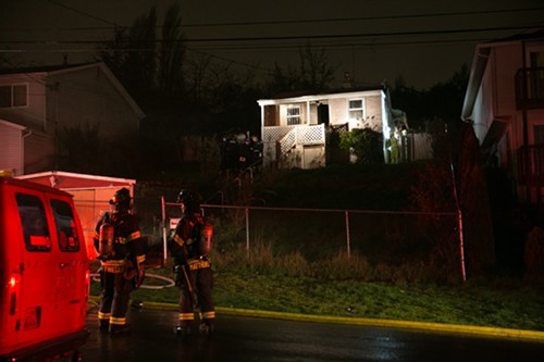 Firefighters look on as the Fire Investigation Service begins preliminary investigation
