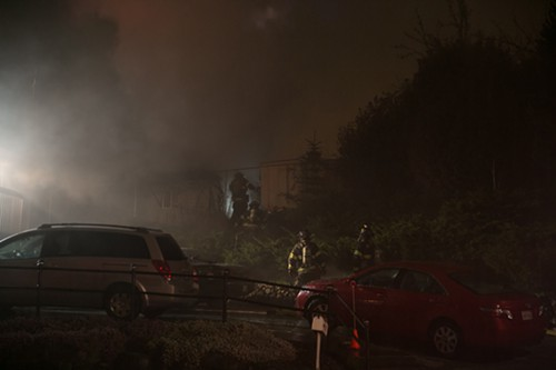 Firefighters search for additional victims in a house fire that claimed one life on Beacon Hill