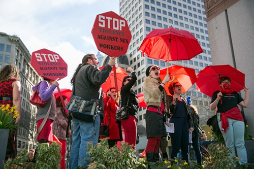 Sex workers and supporters rally at Westlake Park after marching through Seattle